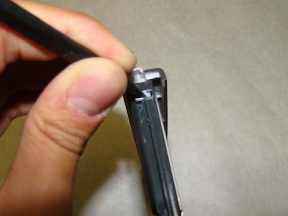 Use a spudger or similar tool to unclip each tab. The cover should come right off.