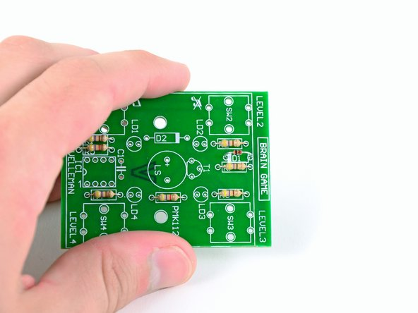 Image 2/3: Use the same method you used to solder the resistors to the board to install the diode.