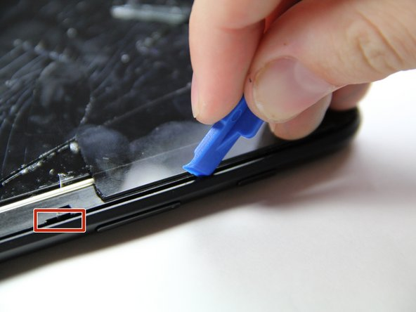 To remove the back panel of the device, start by attempting to fit the plastic opening tool in the crease between the screen and the back panel of the tablet.