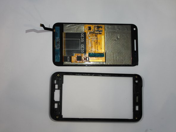 Using the plastic opening tool to pry around the edges, release the touch screen from the screen frame.