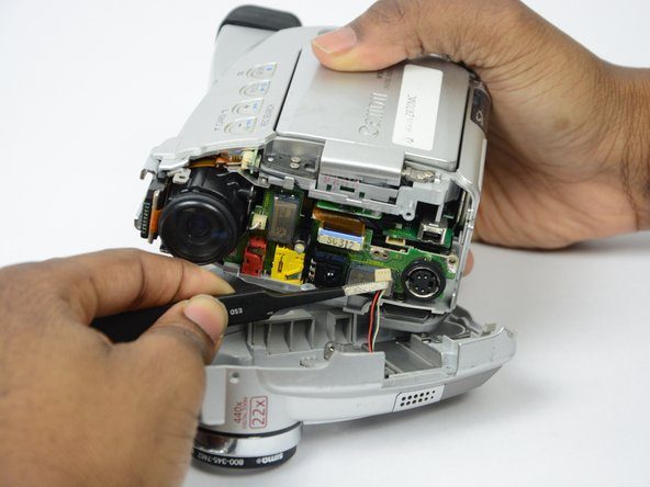 Pull the front panel completely away from the main body of the camcorder.