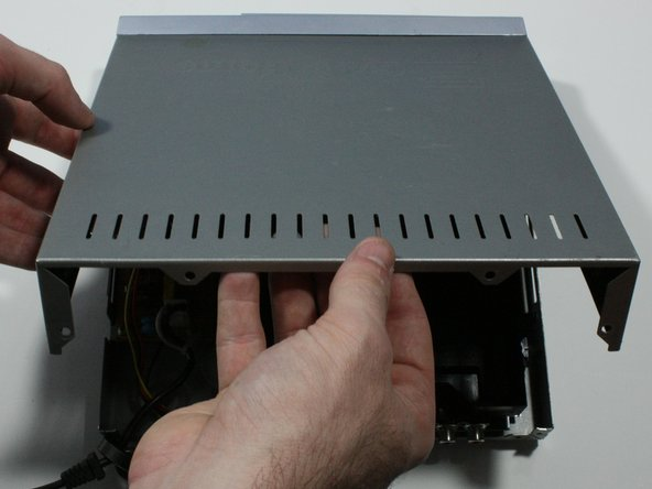 Remove the top panel of the DVD Player by: