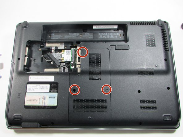 Flip the laptop over and locate the memory module panel and loosen the 3 screws holding down the panel.
