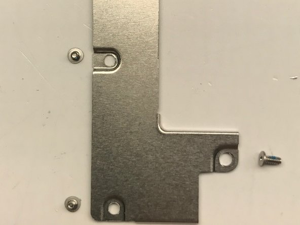 Four screws hold the lower FPC plate in place. These are also #000 tri-tip screws.