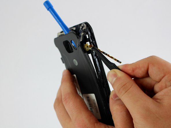 Insert the tweezers under the contact points to undo the connection.