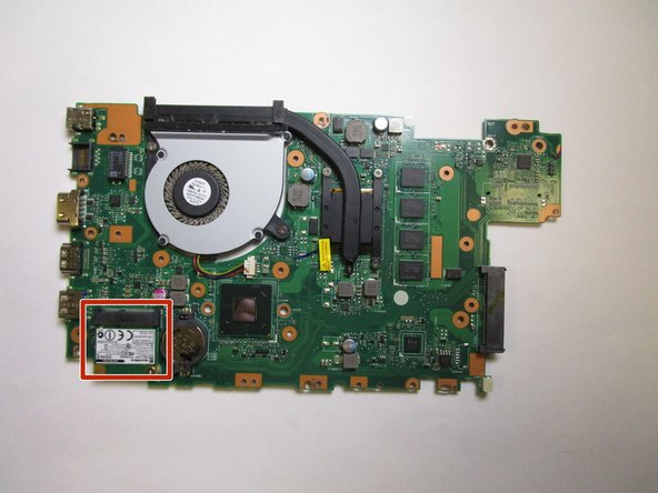 Flip over the motherboard so that the network card is now visible.