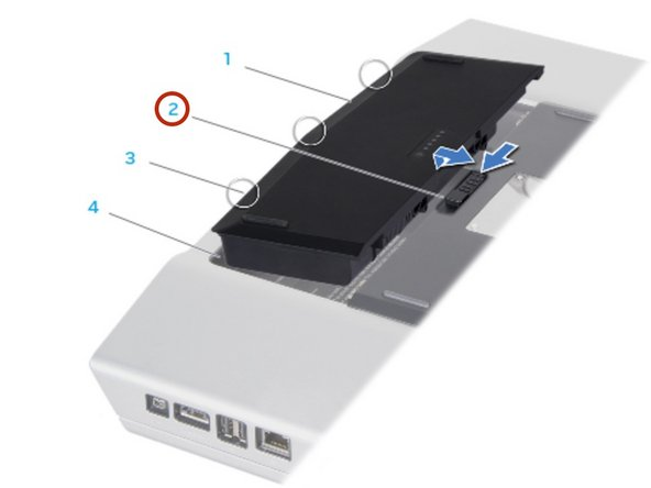 Slide the battery latch to the unlock position as shown.