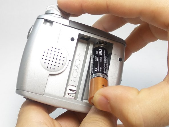 Image 2/3: Remove the batteries.