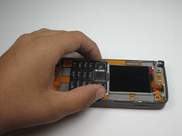 With the front cover off, the screen and keypad should be loose.