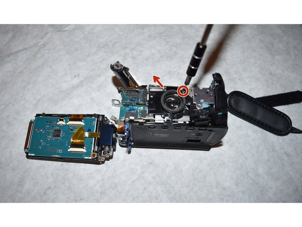 Image 2/2: Once the screw is removed, the speaker can be separated from the camcorder
