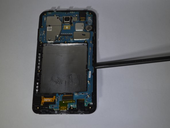 Remove the motherboard assembly from the display assembly with the a spudger or hand.