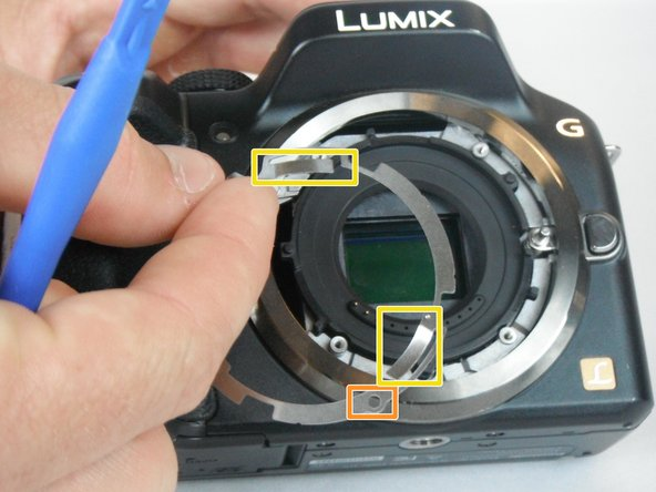 Image 2/2: The three short depressed sections of the internal ring should be facing into the camera during reassembly.