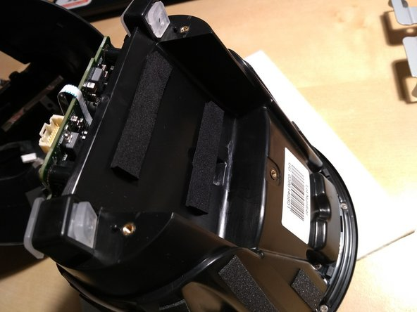 The battery can then be gently pulled off the mid frame as it is held on by double sided adhesive foam tape.