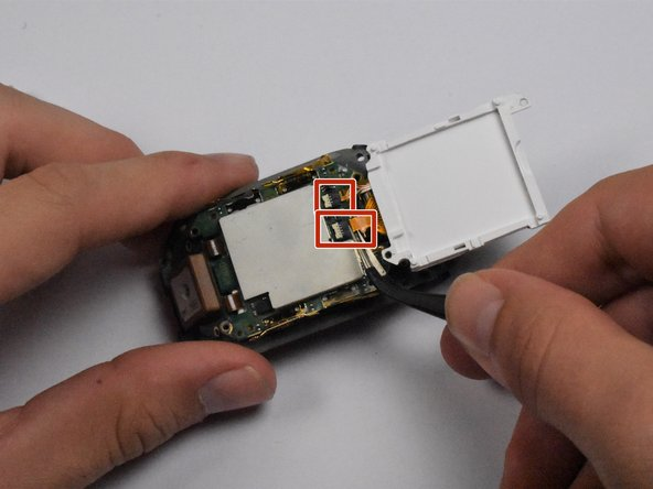 Using tweezers, gently pull the display wiring out of the two connectors that attach the display to the motherboard.