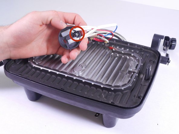 Using the PH2 screwdriver, remove the single 10mm screw on the circular plastic LED tray.