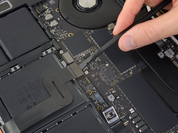 Use a spudger to disconnect the trackpad cable by prying its connector straight up from the logic board.