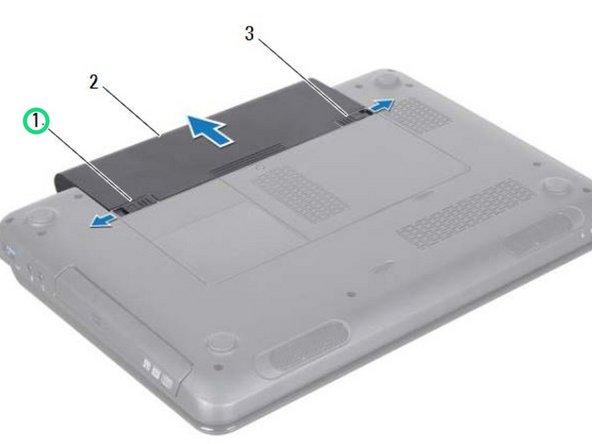 Deslice el pestillo de liberación de la batería a la posición de desbloqueo.
