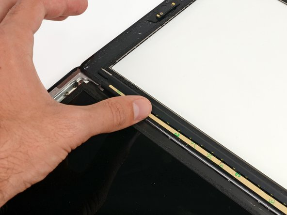 If you've already attached the digitizer cable, you'll have to work around/under it to attach this strip.