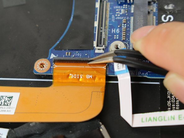 Use tweezers to detach the orange ribbon connector from the ZIF by pulling it towards yourself.