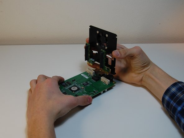 Pull out the fan wire. If you need you can use a flat screwdriver, paying attention not to break it.