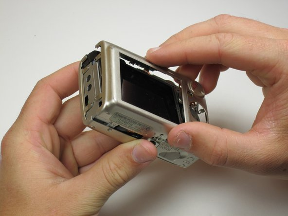 Now the camera body is loose. gently lift the rear of the case to remove it from the camera.