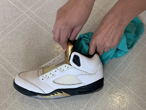 Insert one of your old t-shirts into the front of the shoe in order to stuff the toe box.