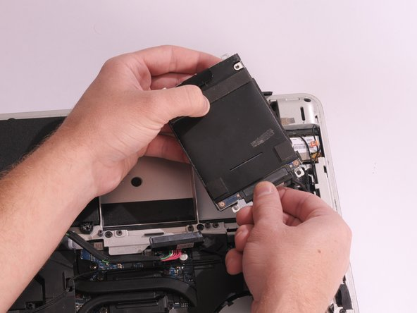 Remove the hard drive by lifting it out of its cavity.