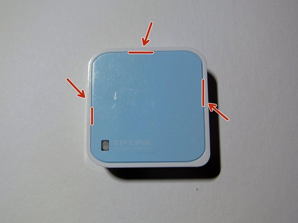 On the top of the router, there is a blue panel that is the case. It is held on by clips, holding it in place.