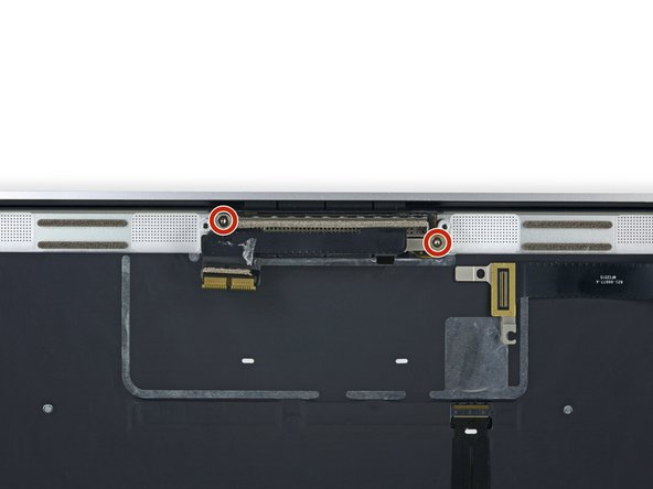 Remove the two 3.3 mm T5 Torx screws securing the display cable assembly.