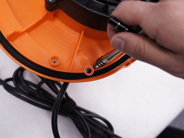 Remove the 15 mm T20 screw. This screw is located nearest the power cord.