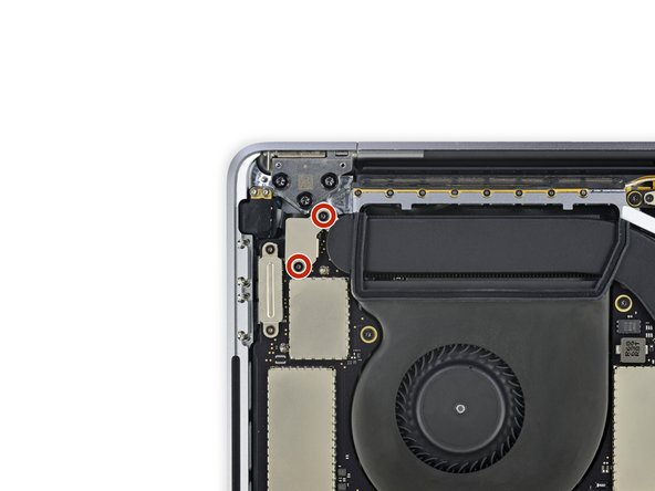 Use a T3 Torx driver to remove the two 2.4 mm screws securing the cover bracket for the Touch ID and headphone jack cable connectors.