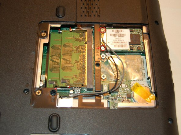 Image 2/3: Remove the mini-pci wireless card and memory, place in an anti-static bag.