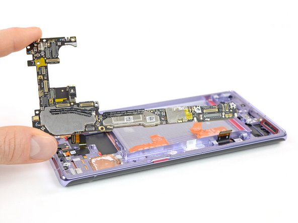 With all those things crammed into the phone, the motherboard is shaped to fill the remaining space. Let's see what goodies we can find on this chocolate silicon bar: