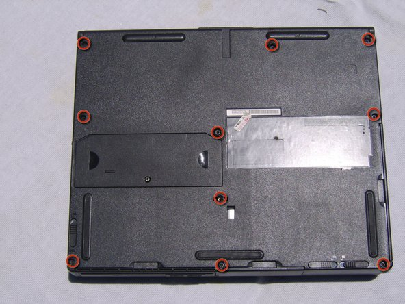 Locate and remove the 10 screws found on the bottom of the laptop using the 3.0 mm Flathead Screwdriver.