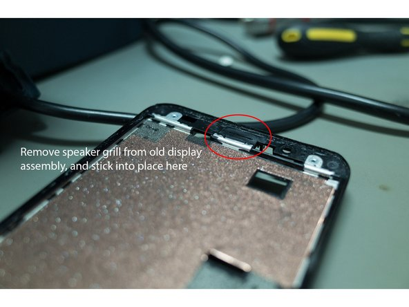 You will need to separate the speaker grill from the original display, clean the adhesive off, and attach it for the new screen. I found it easier to attach the grill to the actual phone body (rather than the display assembly).