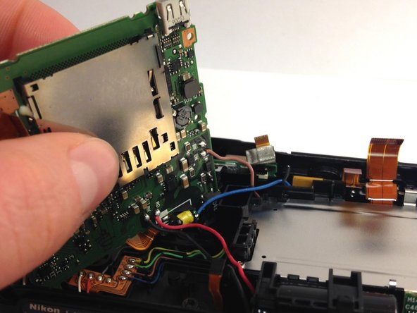 Flip the remaining piece over, careful not to rip any of the connecting wires.