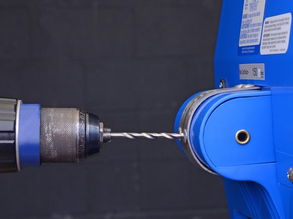 This step shows how to drill a rivet out.