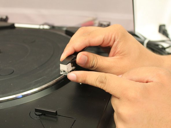 Push up and into the tone arm until you hear a click.