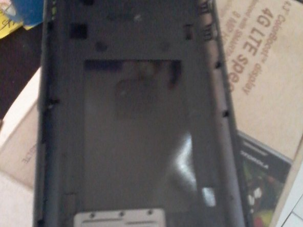 Use the pry tool around edges of case where keyboard is located to take the back cover off. Be careful not to break the cover where the SD card slot is; the cover is very thin and fragile in that area. (I broke mine.)