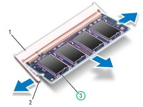 Use your fingertips to carefully spread apart the securing clips on each end of the memory-module connector until the module pops up.