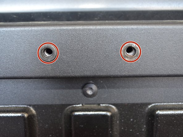 Line up the holes of the new retention pin and put the bolts in them.
