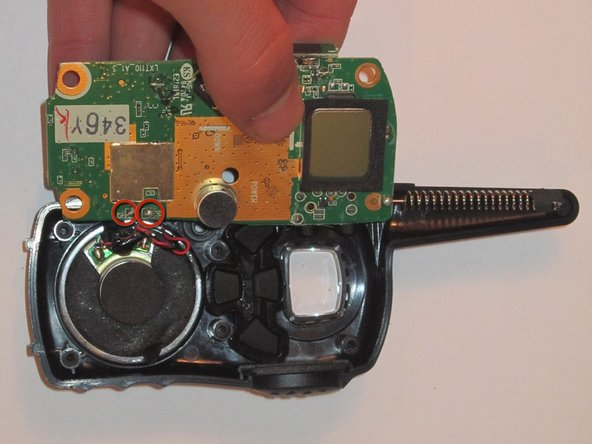 Remove the circuit board from the front part of the radio case.