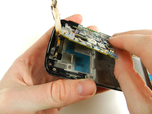Carefully remove the motherboard using your hands.