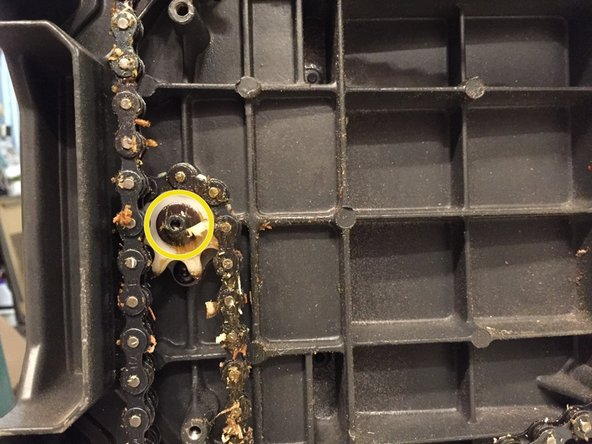 Remove one M5 x 16mm screw from the elevation sprocket using a 3mm allen wrench. Temporarily put the handwheel back on, providing leverage to unscrew screw. Once removed, the elevating shaft can be carefully pulled from the gear.