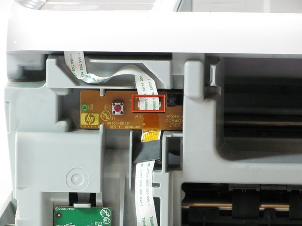 Image 2/2: Remove the cable connecting the top panel of the printer to the power button assembly.