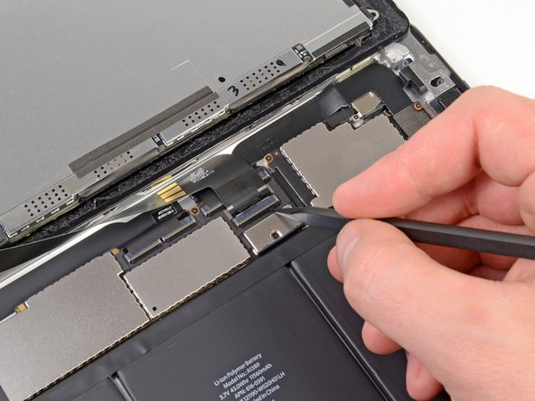 Image 1/3: Using your fingers or a pair of tweezers, pull the LCD ribbon cable from its socket on the logic board.