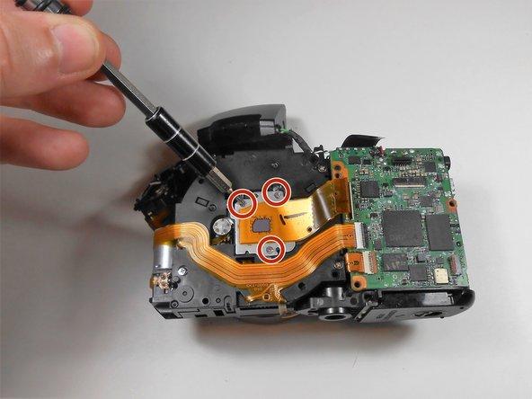 Remove the three 2 mm screws from around the sensor.