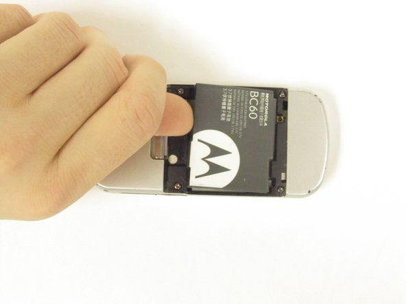Remove the battery by pressing on the edge of the battery from the top of the phone towards the bottom and lifting up.