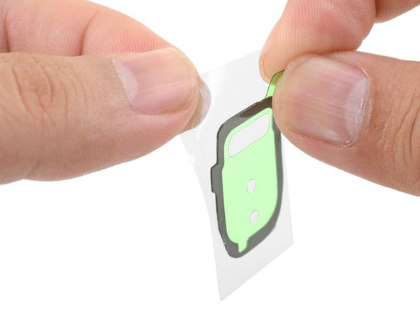 Peel away the clear plastic liner from the bezel adhesive strip to expose the adhesive.