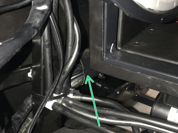 """This is an extremely vague photo , but the quick disconnect is located in the sheath on the lower left hand side of the chair . DON""""T  CUT THE SHEATHING JUST THE ZIP TIES . If you cant  get this zip tied onto the frame like the factory had it no worries just make sure its secured in the general location with zip ties ."""
